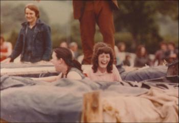 Laura Ashley, 'It's a knockout' with Gwlithyn in pink. Laura Ashley's son Nick in the background, 1970s.