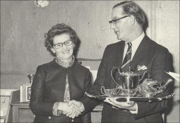 Susie receiving a tea set for 35 years service, 1968