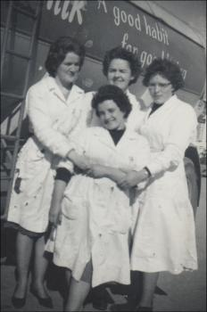 Mair, back centre, with co-workers, note the acid burns in the overalls
