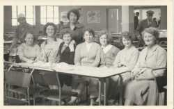 Dunlop workers in canteen 1950s: speaker, Pat Howells second from left � supervisor.