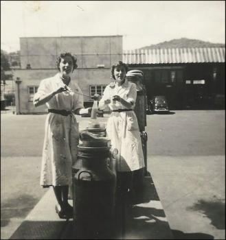 Meiryl James and friend testing milk on the 'deck' at the Felinfach Creamery, c.1959